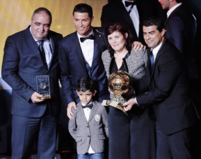Cris and family with his award