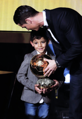 Cris lets Cris hold his award