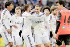 Ramos embracing Benzema