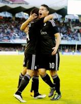 James celebrates with Chicharito