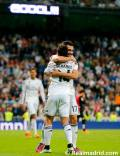 Arbeloa hugs Chicharito for the pass