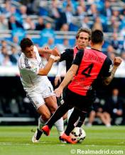 Chicharito muscled off the ball