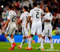 Varane high fives Marcelo