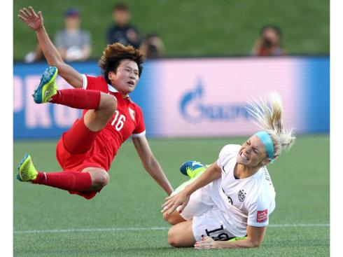 OTTAWA, ON - JUNE 26:  Lou Jiahui #16 of China and Julie Johnston #19 of the United States collide in the first half in the FIFA Women's World Cup 2015 Quarter Final match at Lansdowne Stadium on June 26, 2015 in Ottawa, Canada.  (Photo by Jana Chytilova/Freestyle Photo/Getty Images)