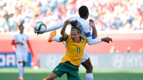 WINNIPEG, MB - JUNE 12:  Lisa De Vanna #11 of Australia collides with Evelyn Nwabuoku #14 of Nigeria as they compete for a header during the FIFA Women's World Cup Canada 2015 match between Australia and Nigeria at Winnipeg Stadium on June 12, 2015 in Winnipeg, Canada.  (Photo by Kevin C. Cox/Getty Images)