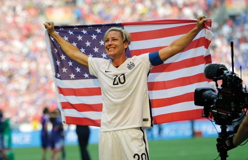 United States' Abby Wambach holds up the U.S. flag as she celebrates after the U.S. beat Japan 5-2 in the FIFA Women's World Cup soccer championship in Vancouver, British Columbia, Canada, Sunday, July 5, 2015. (AP Photo/Elaine Thompson)
