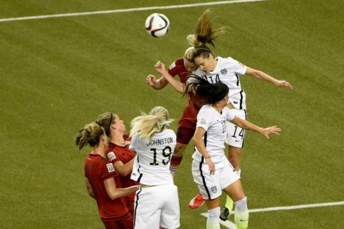 Jun 30, 2015; Montreal, Quebec, CAN; United States midfielder Morgan Brian (14) and Germany forward Alexandra Popp (18) collide attempting a header during the first half of the semifinals of the FIFA 2015 Women's World Cup at Olympic Stadium. Brian and Popp were injured on the play. Mandatory Credit: Eric Bolte-USA TODAY Sports - RTX1IIDQ