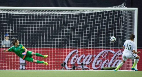 United States' Carli Lloyd (10) scores a penalty shot against Germany keeper Nadine Angerer during the second half of a semifinal in the Women's World Cup soccer tournament, Tuesday, June 30, 2015, in Montreal, Canada. The United States won 2-0. (Graham Hughes/The Canadian Press via AP)