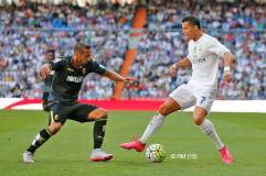 Cris and a defender