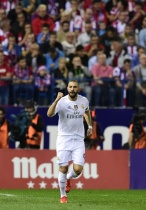 Real Madrid's French forward Karim Benzema celebrates after scoring during the Spanish league football match Club Atletico de Madrid vs Real Madrid CF at the Vicente Calderon stadium in Madrid on October 4, 2015. AFP PHOTO/ JAVIER SORIANO (Photo credit should read JAVIER SORIANO/AFP/Getty Images)
