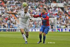 Danilo goes for the ball