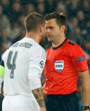 Real Madrid's Sergio Ramos, left, reacts to referee Nicola Rizzoli of Italy after receiving a yellow card during the Champions League group A soccer match between Paris St Germain and Real Madrid at the Parc des Princes stadium in Paris, Wednesday, Oct. 21, 2015. (AP Photo/Michel Euler)