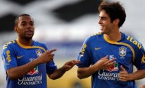 Brazil's Robinho, left, and Kaka practice during a training session in Recife, Brazil, June 8, 2009. Kaka has undergone a battery of medical exams requested by Real Madrid in advance of his proposed transfer from AC Milan, the Brazilian Football Confederation said Monday. Brazil will face Paraguay in a World Cup 2010 qualifying soccer game in Recife on Wednesday. (AP Photo/Roberto Candia)