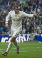 Real Madrid's Welsh forward Gareth Bale celebrates a goal during the Spanish league football match Real Madrid CF vs Getafe CF at the Santiago Bernabeu stadium in Madrid on December 5, 2015. AFP PHOTO / CURTO DE LA TORRE / AFP / CURTO DE LA TORRE (Photo credit should read CURTO DE LA TORRE/AFP/Getty Images)