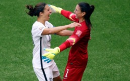 Jul 5, 2015; Vancouver, British Columbia, CAN; United States midfielder Carli Lloyd (10) celebrates with goalkeeper Hope Solo (1) after scoring against Japan during the first half of the final of the FIFA 2015 Women's World Cup at BC Place Stadium. Mandatory Credit: Erich Schlegel-USA TODAY Sports