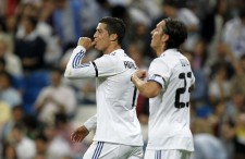 MADRID, SPAIN - MAY 10: Cristiano Ronaldo of Real Madrid celebrates near by Mesut Ozil after scoring his side opening goal during the La Liga match between Real Madrid and Getafe at Estadio Santiago Bernabeu on May 10, 2011 in Madrid, Spain. (Photo by Angel Martinez/Getty Images)