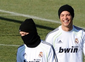 Real Madrid's Portuguese forward Cristiano Ronaldo (R) and Real Madrid's German midfielder Mesut Ozil take part in a training session at Real Madrid Sport City in Madrid on February 1, 2011. AFP PHOTO/DOMINIQUE FAGET (Photo credit should read DOMINIQUE FAGET/AFP/Getty Images)