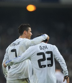 MADRID, SPAIN - JANUARY 13: Mesut Ozil of Real Madrid celebrates with Cristiano Ronaldo after scoring Real's third goal during the Copa del Rey quarter final first leg match between Real Madrid and Atletico Madrid at Estadio Santiago Bernabeu on January 13, 2011 in Madrid, Spain. (Photo by Denis Doyle/Getty Images)