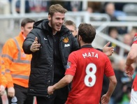 """Manchester United's Juan Mata (R) celebrates with teammate goalkeeper David De Gea after scoring a goal against Newcastle United during their English Premier League soccer match at St James' Park in Newcastle, northern England April 5, 2014. REUTERS/Nigel Roddis (BRITAIN - Tags: SPORT SOCCER) FOR EDITORIAL USE ONLY. NOT FOR SALE FOR MARKETING OR ADVERTISING CAMPAIGNS. NO USE WITH UNAUTHORIZED AUDIO, VIDEO, DATA, FIXTURE LISTS, CLUB/LEAGUE LOGOS OR """"LIVE"""" SERVICES. ONLINE IN-MATCH USE LIMITED TO 45 IMAGES, NO VIDEO EMULATION. NO USE IN BETTING, GAMES OR SINGLE CLUB/LEAGUE/PLAYER PUBLICATIONS - RTR3K2C6"""