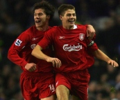 Liverpool's Steven Gerrard celebrates with Xabi Alonso (L) after scoring against Everton during their English Premier League soccer match at Goodison Park in Liverpool, northern England, December 28, 2005. NO ONLINE/INTERNET USE WITHOUT A LICENCE FROM THE FOOTBALL DATA CO LTD. FOR LICENCE ENQUIRIES PLEASE TELEPHONE +44 207 298 1656. REUTERS/Mike Finn-Kelcey Picture Supplied by Action Images *** Local Caption *** 2005-12-28T210259Z_01_MFK603D_RTRIDSP_3_SPORT-SOCCER.jpg