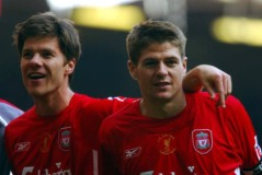 Liverpool's Xabi Alonso and Steven Gerrard celebrate winning the FA Cup