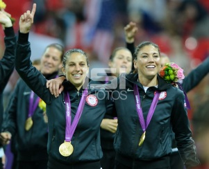 London, England - Thursday, August 9, 2012: The USA defeated Japan 2-1 to win the London 2012 Olympic gold medal at Wembley Arena. Carli Lloyd and Hope Solo celebrate.