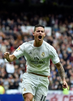 Real Madrid's Colombian midfielder James Rodriguez celebrates after scoring during the Spanish league football match Real Madrid CF vs Athletic Club Bilbao at the Santiago Bernabeu stadium in Madrid on February 13, 2016. / AFP / GERARD JULIEN (Photo credit should read GERARD JULIEN/AFP/Getty Images)