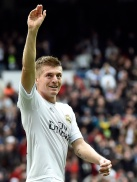 Real Madrid's German midfielder Toni Kroos celebrates after scoring during the Spanish league football match Real Madrid CF vs Athletic Club Bilbao at the Santiago Bernabeu stadium in Madrid on February 13, 2016. / AFP / GERARD JULIEN (Photo credit should read GERARD JULIEN/AFP/Getty Images)