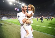 Bale and his daughter
