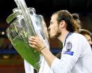 Bale gives big ears a smooch