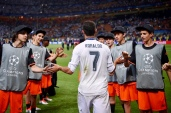 MILAN, ITALY - MAY 28: Cristiano Ronaldo of Real Madrid high fives with ball boys after the UEFA Champions League Final between Real Madrid and Club Atletico de Madrid at Stadio Giuseppe Meazza on May 28, 2016 in Milan, Italy.. (Photo by Stuart Franklin - UEFA/UEFA via Getty Images)
