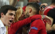 Atletico's Yannick Carrasco gets a kiss as he celebrates after scoring during the Champions League final soccer match between Real Madrid and Atletico Madrid at the San Siro stadium in Milan, Italy, Saturday, May 28, 2016. (AP Photo/Luca Bruno)