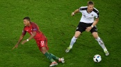 PARIS, FRANCE - JUNE 18: Nani of Portugal goes down after a tackle from Sebastian Proedl of Austria during the UEFA EURO 2016 Group F match between Portugal and Austria at Parc des Princes on June 18, 2016 in Paris, France. (Photo by Mike Hewitt/Getty Images)