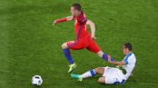 SAINT-ETIENNE, FRANCE - JUNE 20: Jamie Vardy of England is fouled by Viktor Pecovsky of Slovakia resulting in an yellow card during the UEFA EURO 2016 Group B match between Slovakia and England at Stade Geoffroy-Guichard on June 20, 2016 in Saint-Etienne, France. (Photo by Michael Steele/Getty Images)