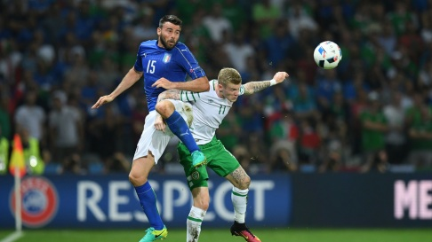 LILLE, FRANCE - JUNE 22: Andrea Barzagli of Italy and James McClean of Republic of Ireland compete for the ball during the UEFA EURO 2016 Group E match between Italy and Republic of Ireland at Stade Pierre-Mauroy on June 22, 2016 in Lille, France. (Photo by Matthias Hangst/Getty Images)