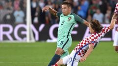 Portugal's defender Raphael Guerreiro (L) vies with Croatia's midfielder Luka Modric during the Euro 2016 round of sixteen football match Croatia vs Portugal, on June 25, 2016 at the Bollaert-Delelis stadium in Lens. / AFP / PHILIPPE HUGUEN (Photo credit should read PHILIPPE HUGUEN/AFP/Getty Images)