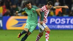 Portugal's forward Cristiano Ronaldo (L) vies with Croatia's defender Darijo Srna during the round of sixteen football match Croatia against Portugal of the Euro 2016 football tournament, on June 25, 2016 at the Bollaert-Delelis stadium in Lens. / AFP / FRANCISCO LEONG (Photo credit should read FRANCISCO LEONG/AFP/Getty Images)