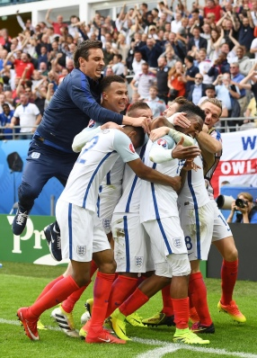 LENS, FRANCE - JUNE 16: Daniel Sturridge (2nd R) of England celebrates scoring his team's second goal with his team mates during the UEFA EURO 2016 Group B match between England and Wales at Stade Bollaert-Delelis on June 16, 2016 in Lens, France. (Photo by Michael Regan - The FA/The FA via Getty Images)