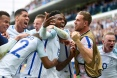 England's forward Daniel Sturridge (C) celebrates scoring the 2-1 goal with team mates during the Euro 2016 group B football match between England and Wales at the Bollaert-Delelis stadium in Lens on June 16, 2016. England won the match 2-1. / AFP / PAUL ELLIS (Photo credit should read PAUL ELLIS/AFP/Getty Images)