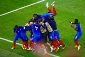 MARSEILLE, FRANCE - JUNE 15: the France squad celebrate with Antoine Griezmann after he scored his sides first goal during the UEFA EURO 2016 Group A match between France and Albania at Stade Velodrome on June 15, 2016 in Marseille, France. (Photo by Lars Baron/Getty Images)