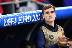 France's forward Antoine Griezmann sits on the sideline during the start of the Euro 2016 group A football match between France and Albania at the Velodrome stadium in Marseille on June 15, 2016. / AFP / FRANCK FIFE (Photo credit should read FRANCK FIFE/AFP/Getty Images)