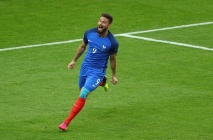 PARIS, FRANCE - JUNE 10: Olivier Giroud of France celebrates scoring his team's first goal during the UEFA Euro 2016 Group A match between France and Romania at Stade de France on June 10, 2016 in Paris, France. (Photo by Paul Gilham/Getty Images)