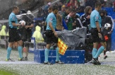 Referees leave the pitch during a hailstorm during the Euro 2016 group C football match between Ukraine and Northern Ireland at the Parc Olympique Lyonnais stadium in Décines-Charpieu near Lyon on June 16, 2016. / AFP / PHILIPPE DESMAZES (Photo credit should read PHILIPPE DESMAZES/AFP/Getty Images)