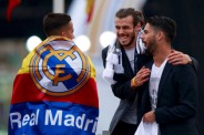 MADRID, SPAIN - MAY 29: Gareth Bale (2ndL) of Real Madrid CF jokes with his teammates Francisco Roman Alarcon alias Isco (R) and Lucas Vazquez (L) during their team celebration at Cibeles square after winning the Uefa Champions League Final match agains Club Atletico de Madrid on May 29, 2016 in Madrid, Spain. (Photo by Gonzalo Arroyo Moreno/Getty Images)