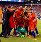 EAST RUTHERFORD, NJ - JUNE 26: Claudio Bravo #1 of Chile is mobbed by his teammates after defeating Argentina to win the Copa America Centenario Championship match at MetLife Stadium on June 26, 2016 in East Rutherford, New Jersey. Chile defeated Argentina 4-2 in penalty kicks. (Photo by Mike Stobe/Getty Images)