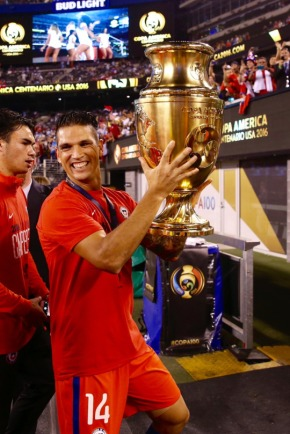 EAST RUTHERFORD, NEW JERSEY - JUNE 26: Mark Gonzalez of Chile holds the trophy during the championship match between Argentina and Chile at MetLife Stadium as part of Copa America Centenario US 2016 on June 26, 2016 in East Rutherford, New Jersey, US. (Photo by Omar Vega/LatinContent/Getty Images)