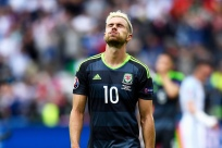 LENS, FRANCE - JUNE 16: Aaron Ramsey of Wales shows his dejection after his team's 1-2 defeat in the UEFA EURO 2016 Group B match between England and Wales at Stade Bollaert-Delelis on June 16, 2016 in Lens, France. (Photo by Mike Hewitt/Getty Images)