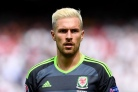 Wales' midfielder Aaron Ramsey looks on during the Euro 2016 group B football match between England and Wales at the Bollaert-Delelis stadium in Lens on June 16, 2016. / AFP / PAUL ELLIS (Photo credit should read PAUL ELLIS/AFP/Getty Images)