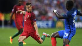 Portugal's defender Raphael Guerreiro (L) and France's midfielder Moussa Sissoko fight for the ball during the Euro 2016 final football match between Portugal and France at the Stade de France in Saint-Denis, north of Paris, on July 10, 2016. / AFP / PATRIK STOLLARZ (Photo credit should read PATRIK STOLLARZ/AFP/Getty Images)