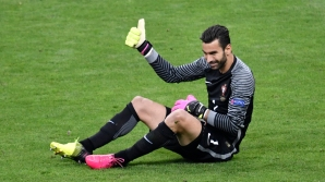 Portugal's goalkeeper Rui Patricio reacts during the Euro 2016 final football match between Portugal and France at the Stade de France in Saint-Denis, north of Paris, on July 10, 2016. / AFP / PHILIPPE LOPEZ (Photo credit should read PHILIPPE LOPEZ/AFP/Getty Images)